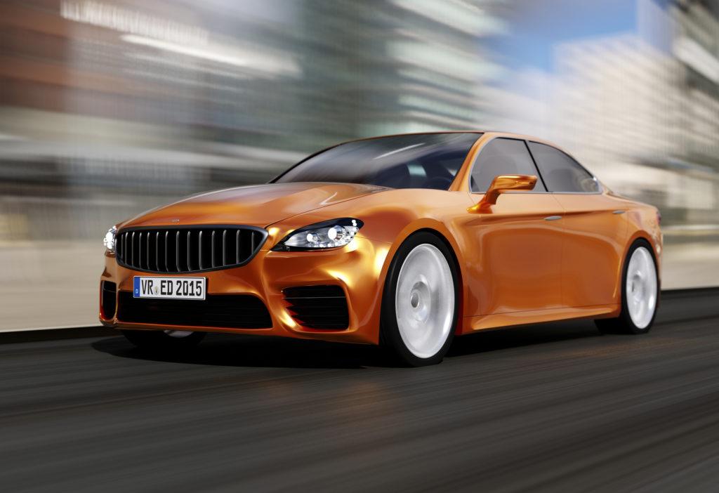 Unbadged orange luxury car on blurred background